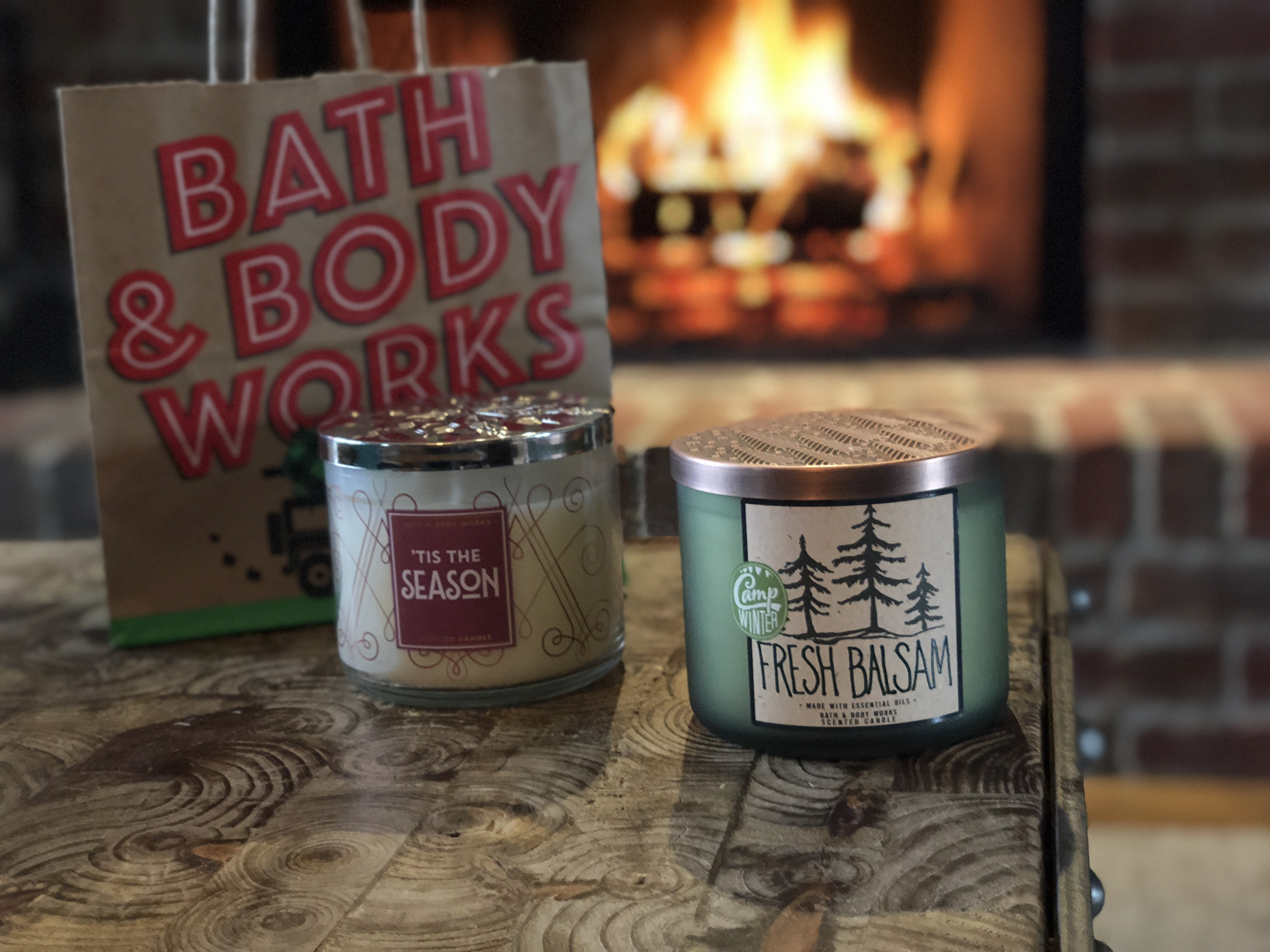16 secrets for saving big at bath & body works – candles on a table near a fireplace