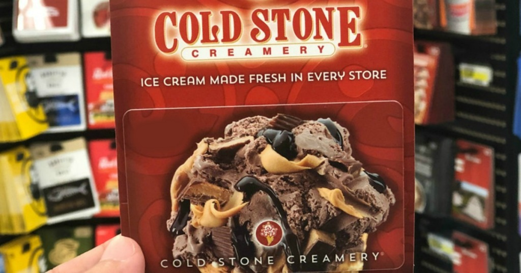 hand holding cold stone creamery gift card in store