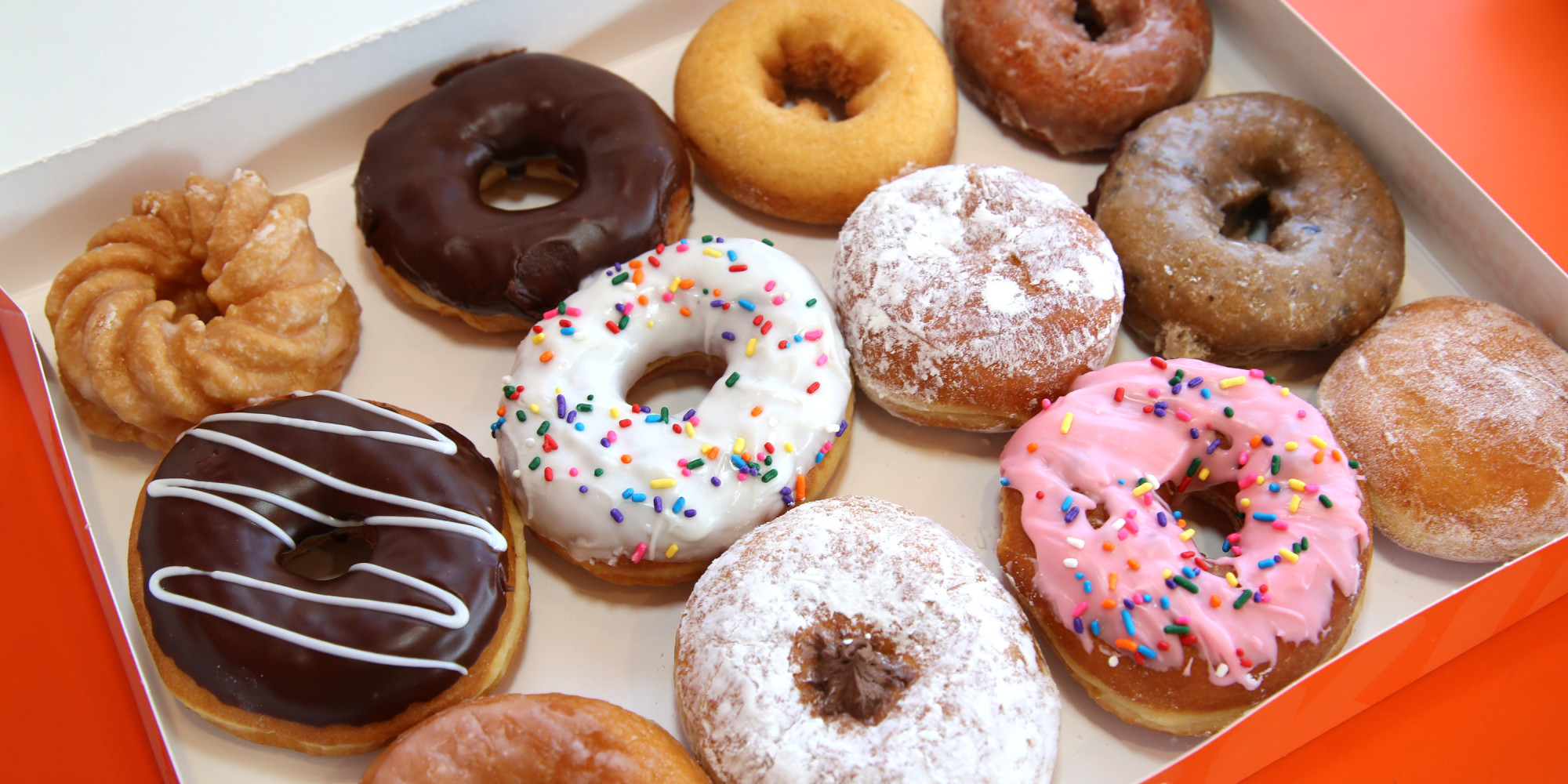 dozen Dunkin' Donuts in package