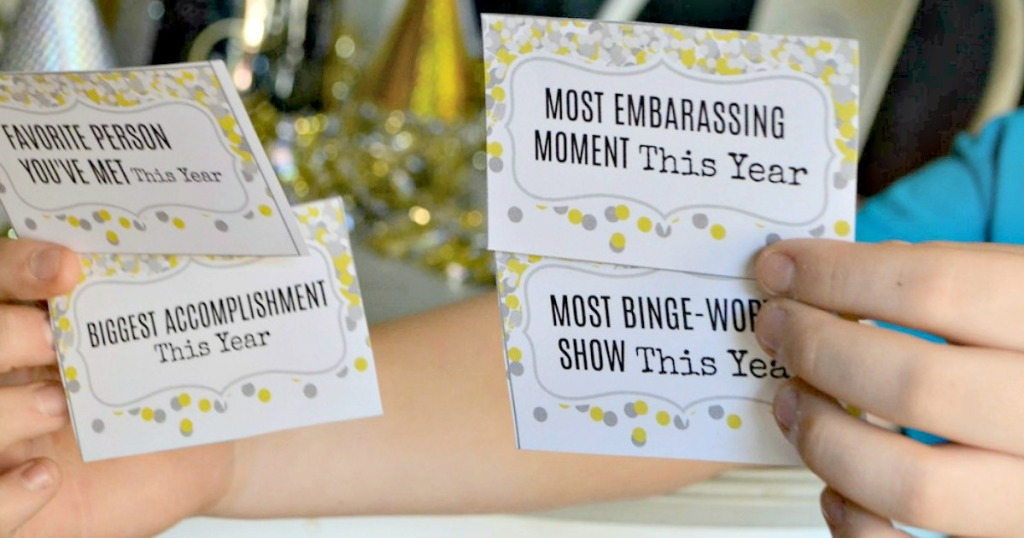 holding New Years Eve Conversation Game printable cards