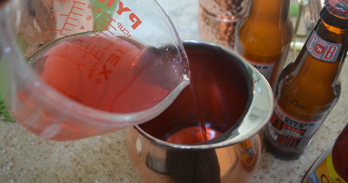 moscow mule punch recipe being poured into a carafe