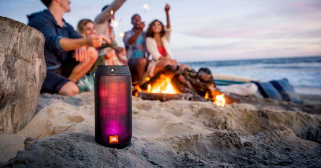 jbl speaker on beach with people in background