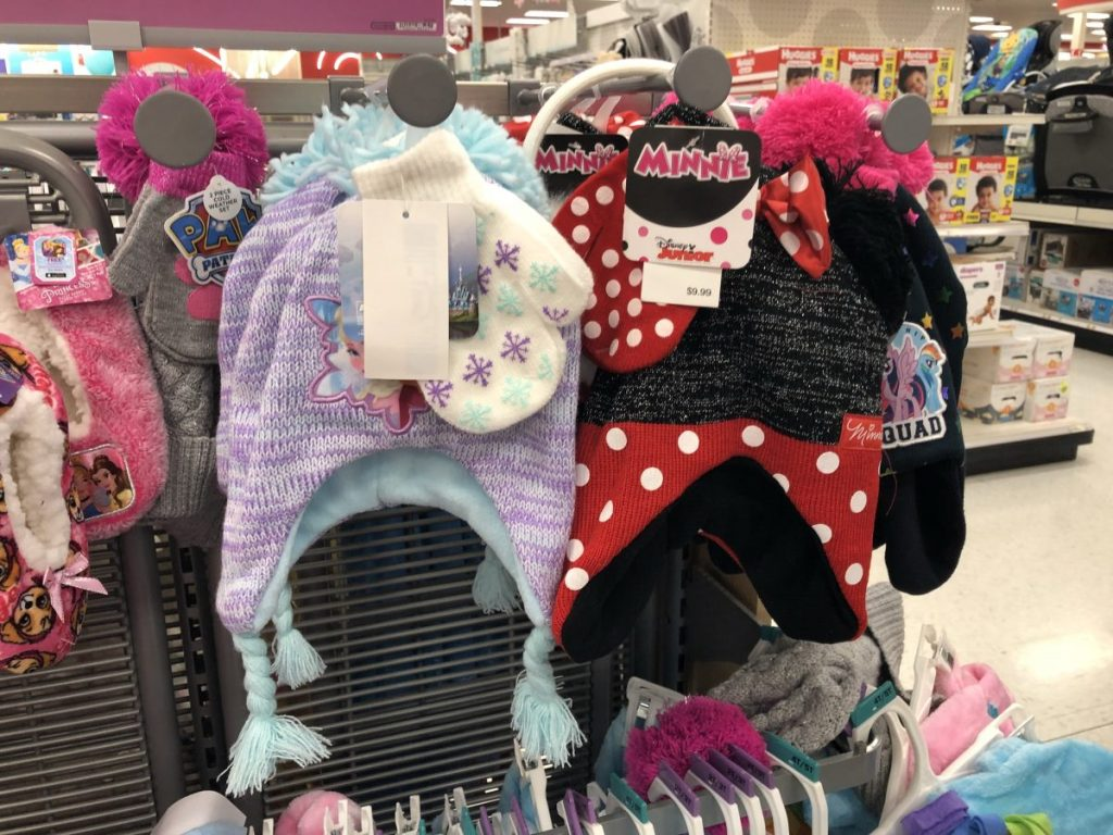 kids hats and mittens sets hanging on store shelf