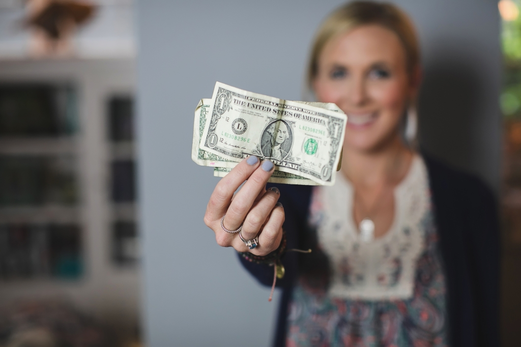 shop and earn rewards with these free mobile apps — Collin holding out dollar bills