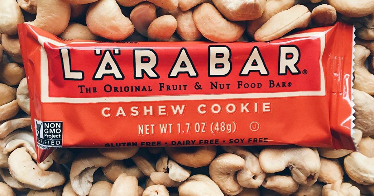 Larabar cashew cookie bar on top of nuts