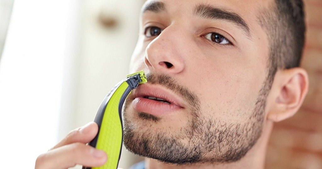 Man using Norelco OneBlade Electric Trimmer