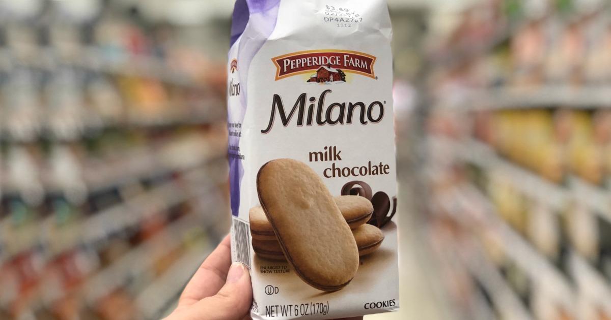 hand holding milano milk chocolate cookies