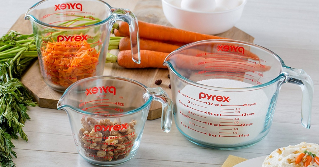 pyrex measuring cups with carrots, milk, and nuts