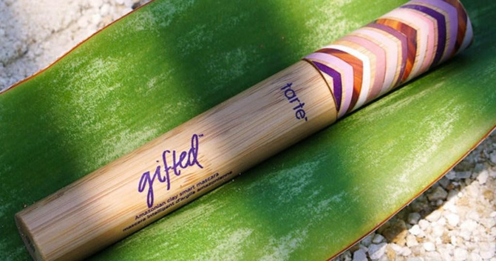 tarte gifted mascara on a green leaf