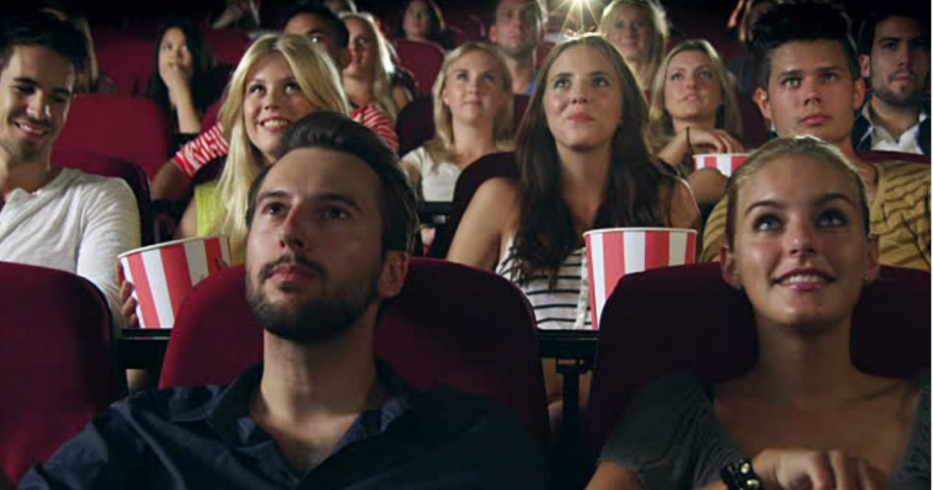 people Watching a movie in the theater