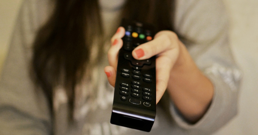 woman with remote control in hand