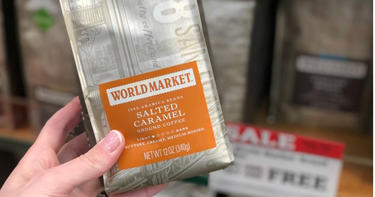 holding bag of World Market coffee