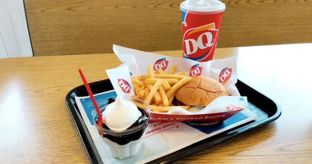 dq soda sundae cheeseburger and fries on a tray