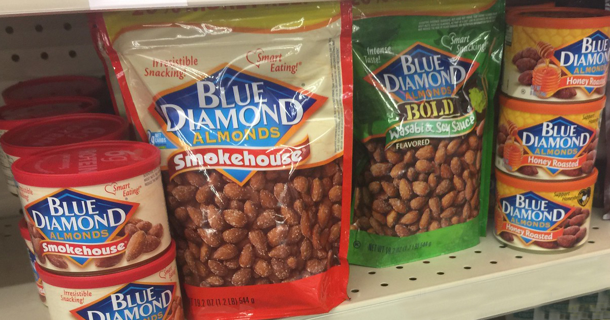 assorted blue diamond almond bags and cans on a store shelf
