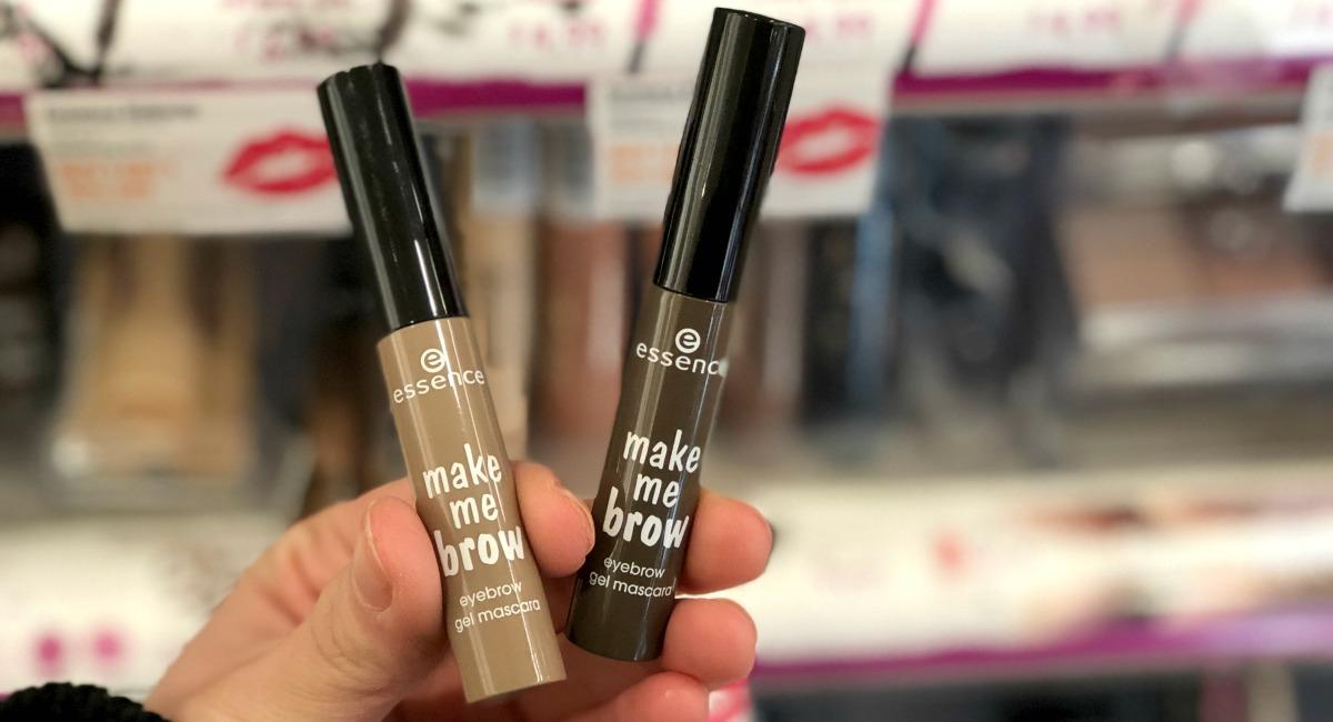 hand holding two sticks of eyebrow gel mascara best make up brands cheap vs luxury