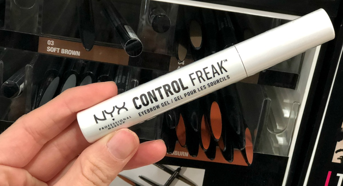 hand holding a stick of nyx control freak best make up brands cheap vs luxury