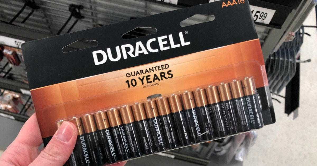 hand holding Duracell batteries