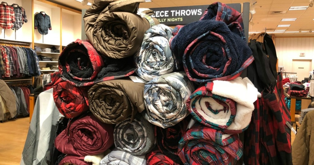 pile of rolled up eddie bauer throws in store