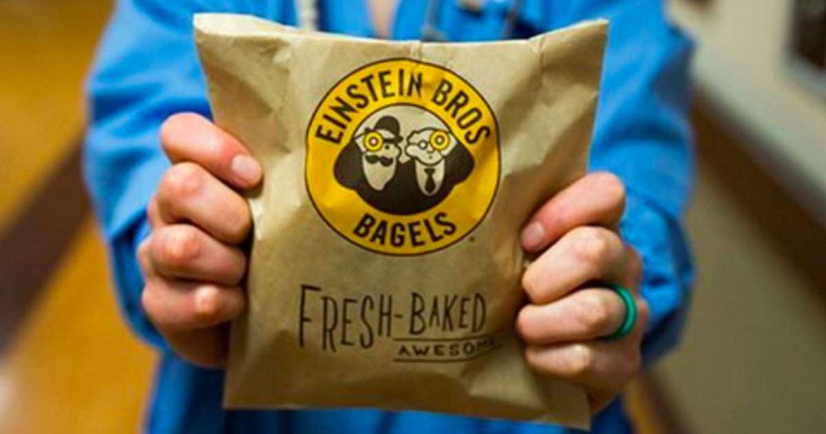 person holding an Einstein Bros Bagels bag