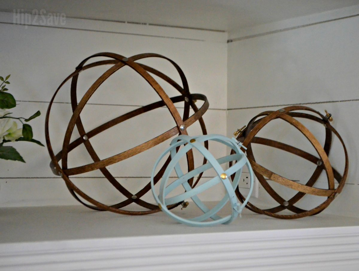 diy farmhouse style orbs using embroidery hoops on a shelf