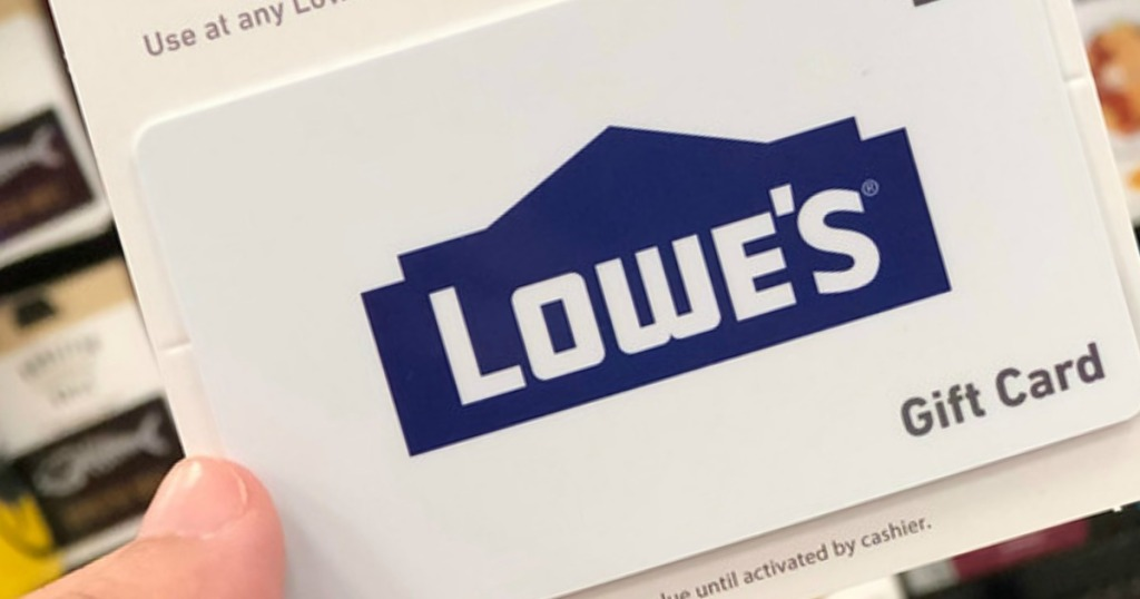 person holding a lowe's gift card