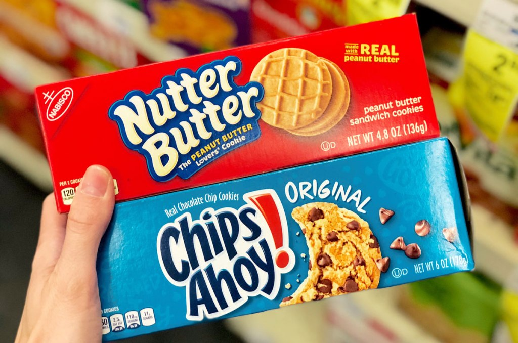 hand holding two boxes of Nabisco cookies