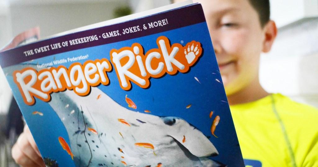 boy reading Ranger Rick magazine