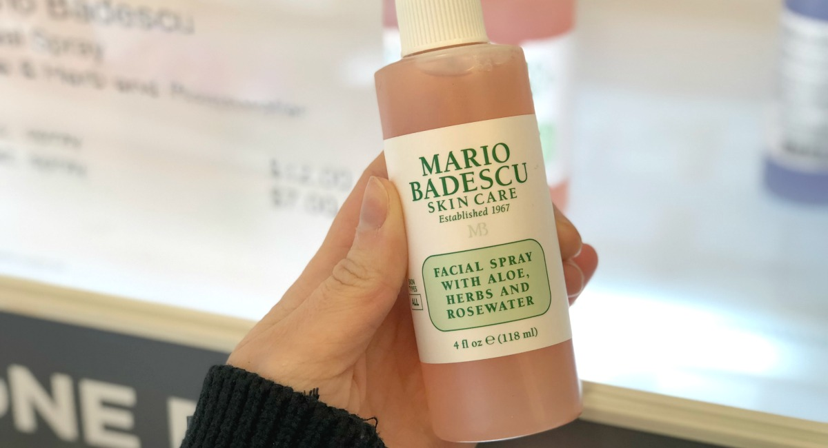 hand holding a bottle of mario badescu skin care best make up brands cheap vs luxury