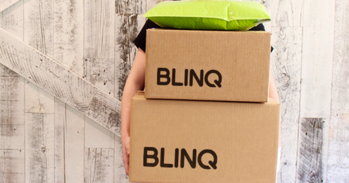 person holding Blinq boxes