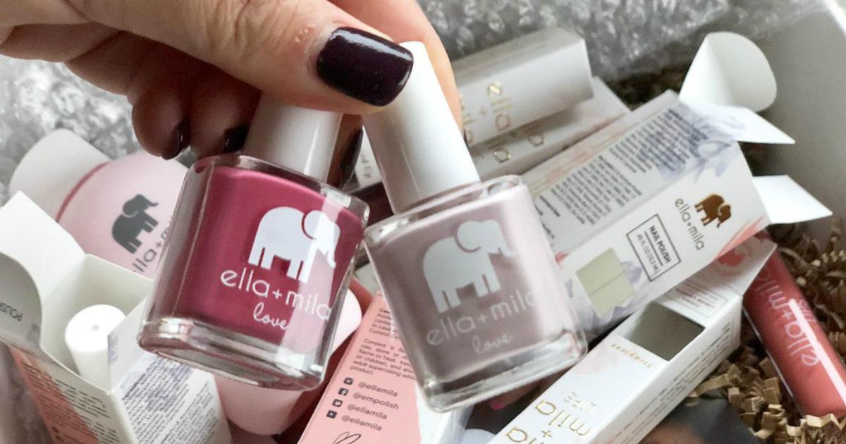 holding ella and mila nail polishes
