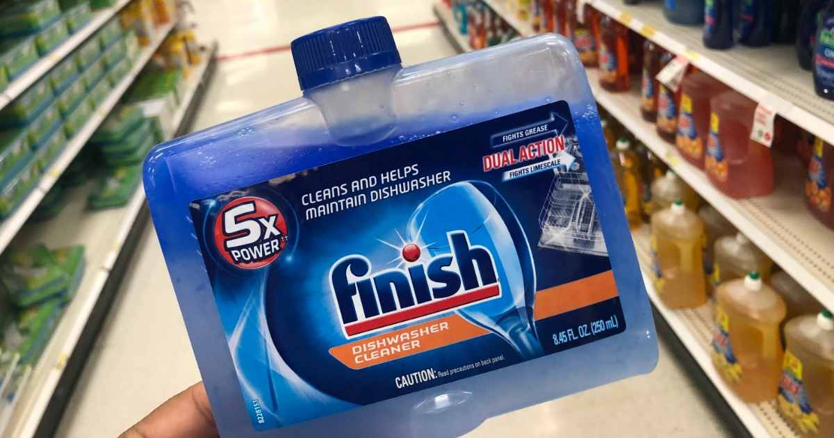 hand holding bottle of finish dishwasher cleaner in store aisle