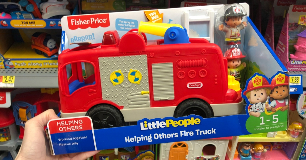 hand holding little people helping others fire truck in store