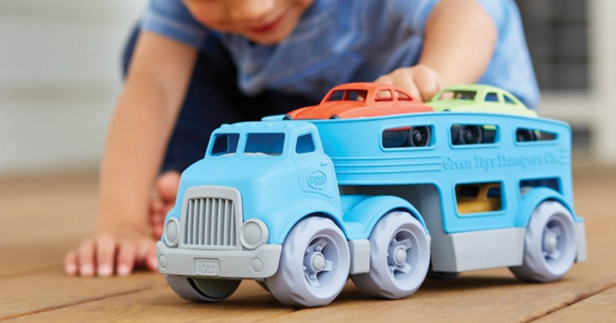 boy playing with blue truck