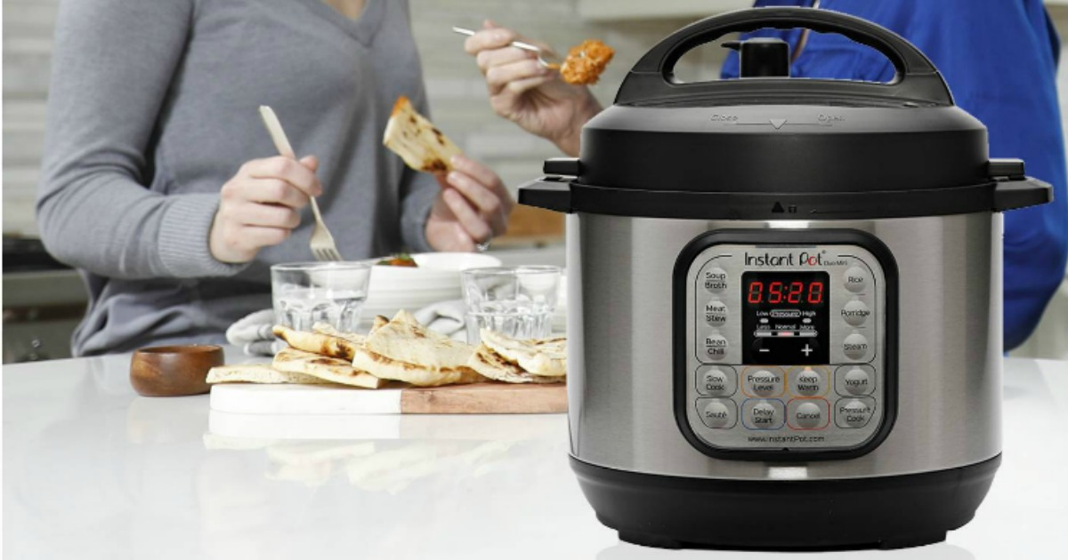 Instant Pot Pressure Cooker 3 Quart with people in the background eating