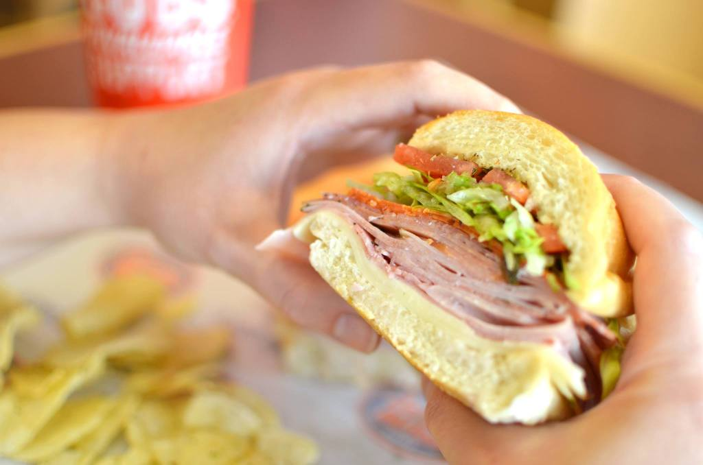 hand holding jersey mike's sub