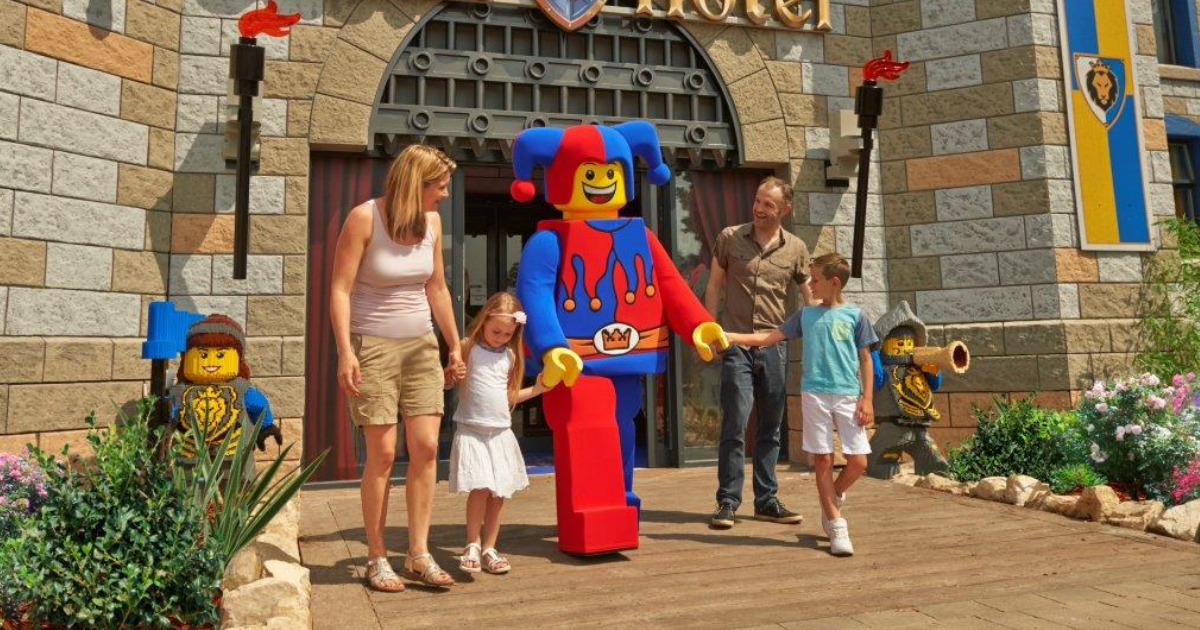 LEGOLAND family having fun and holding hands with a Lego employee