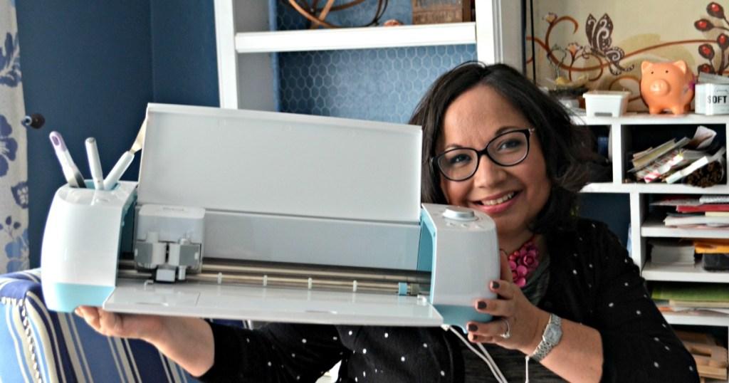 Lina holding up cricut machine