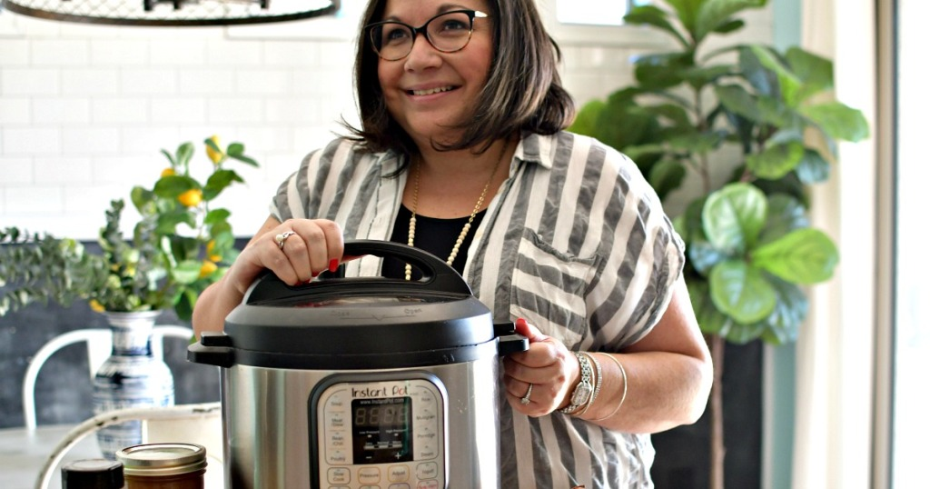 woman with an instant pot on the counter