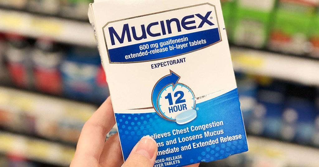 hand holding mucinex box Rite Aid