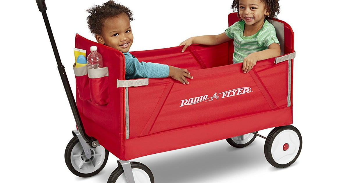 Radio Flyer wagon with two kids sitting inside