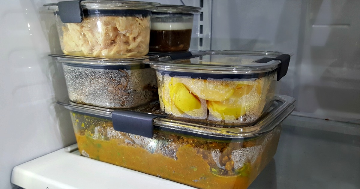 Rubbermaid storage containers with food in them in refrigerator
