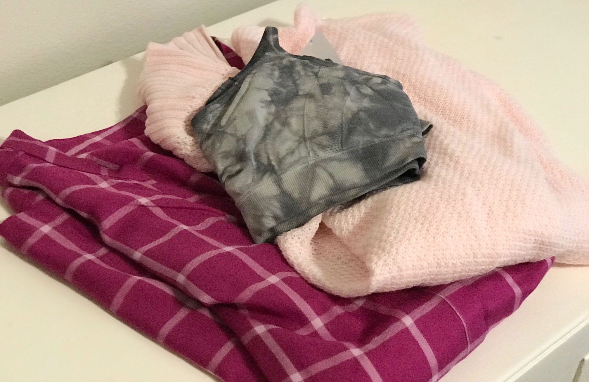 three pieces of clothing on a table