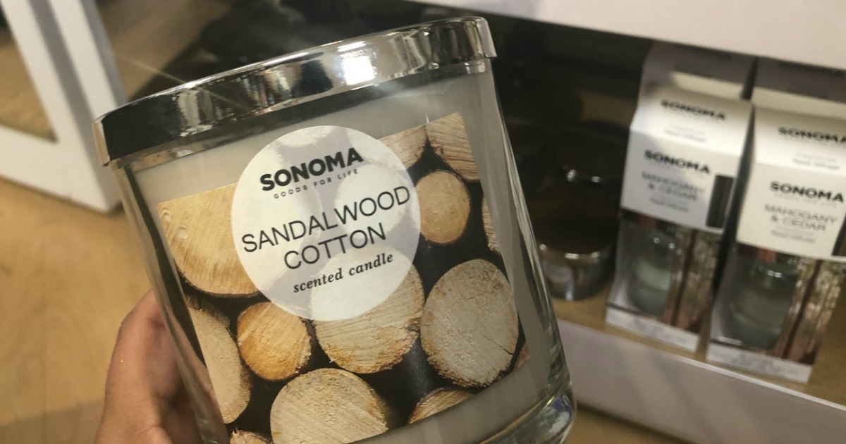 hand holding up sonoma candle