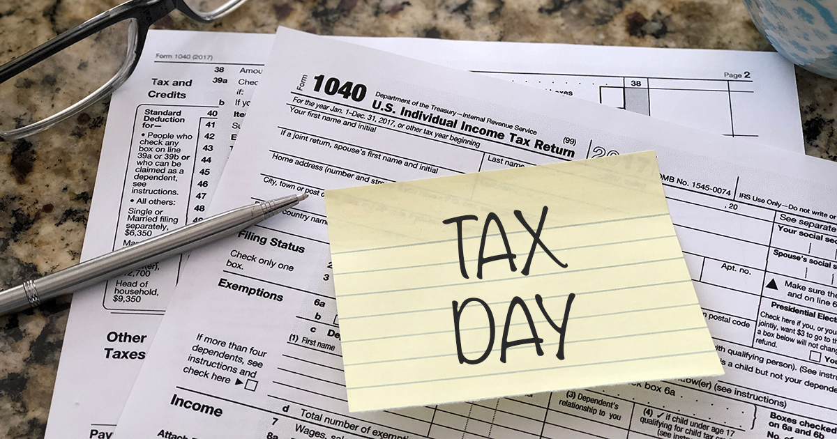 "sticky that reads ""Tax Day"" on a 1040"