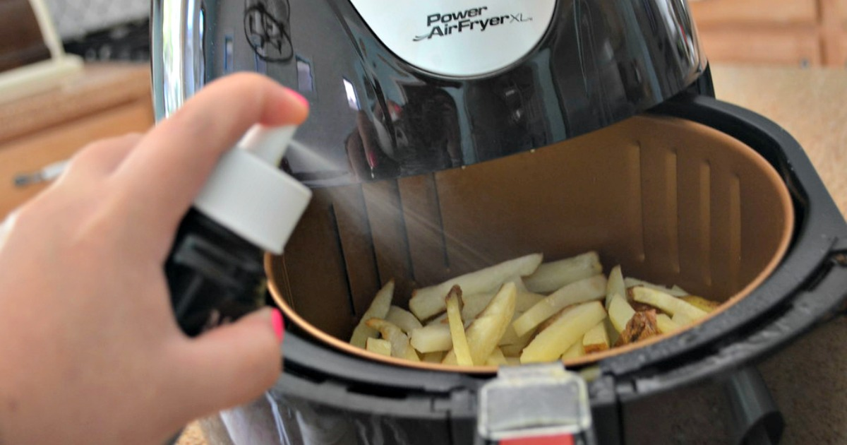Spraying just a little oil on your air fryer french fries is all it takes to get crispy french fries in about 15 minutes.