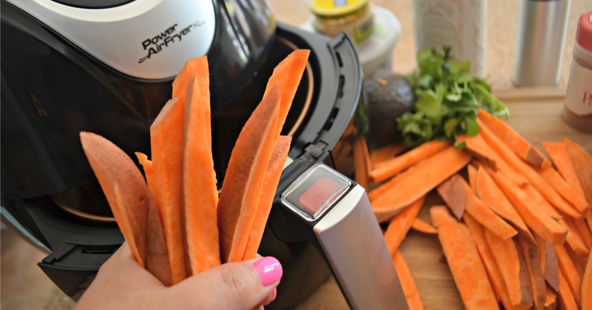These air fryer sweet potato fries with avocado dipping sauce are a new family favorite
