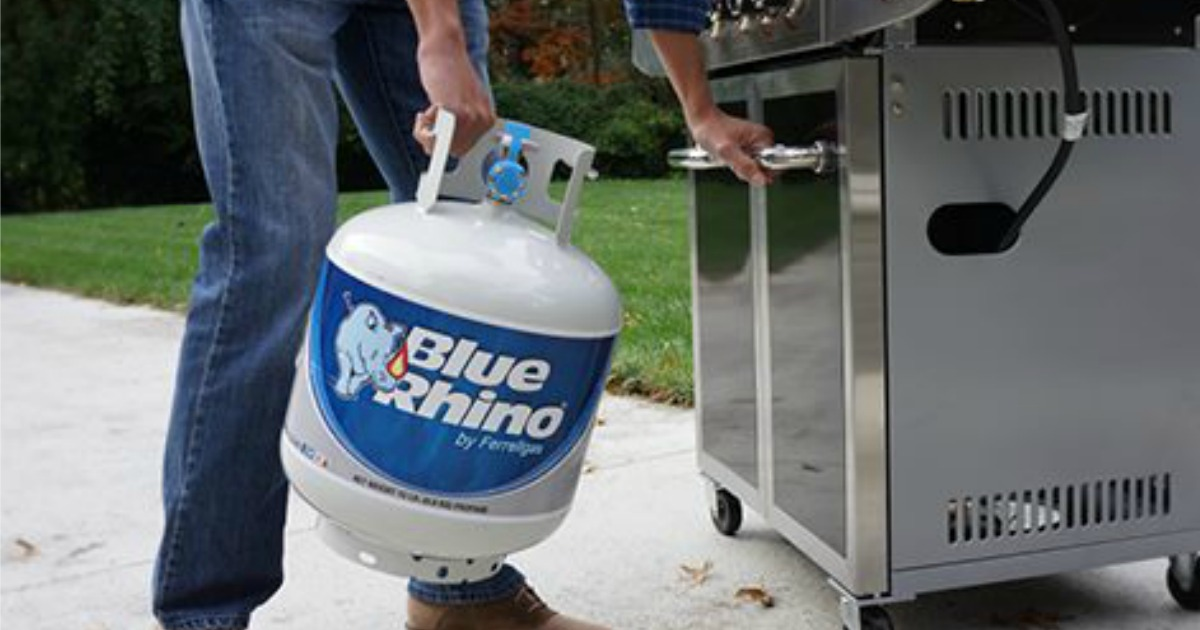 Person putting Blue Rhino Tank on their grill