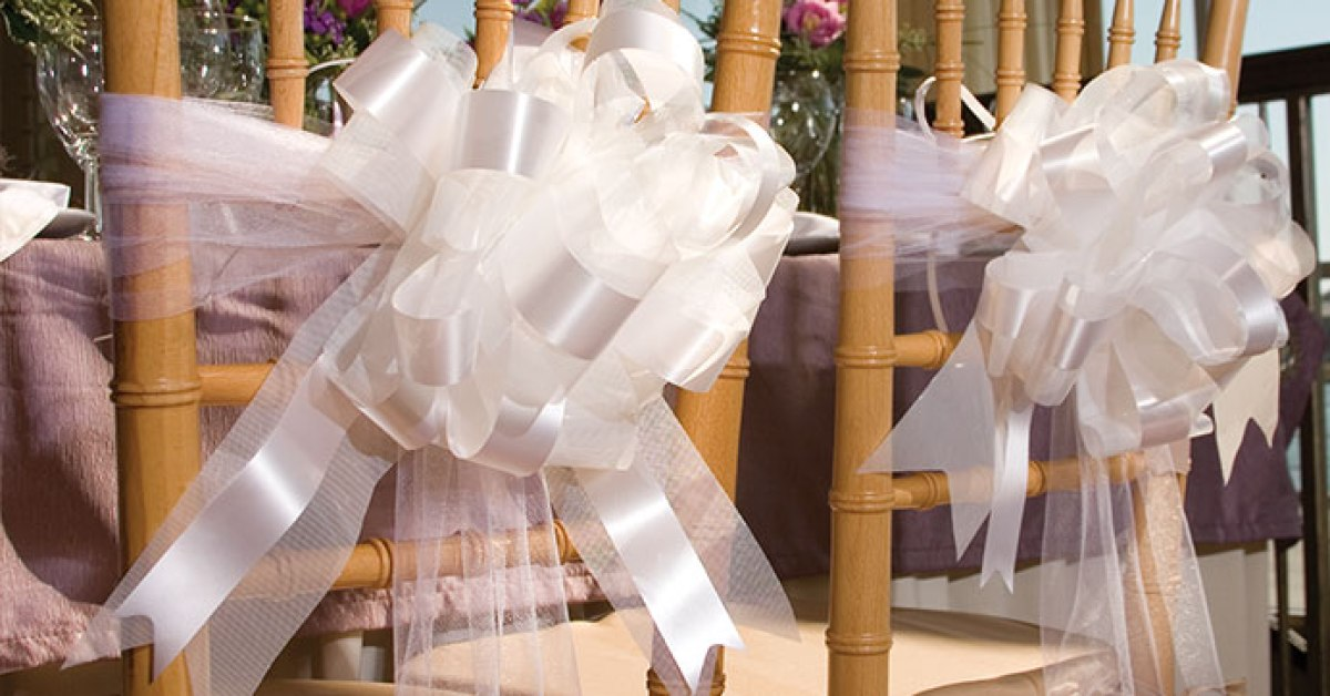 bows on the back of wedding chairs