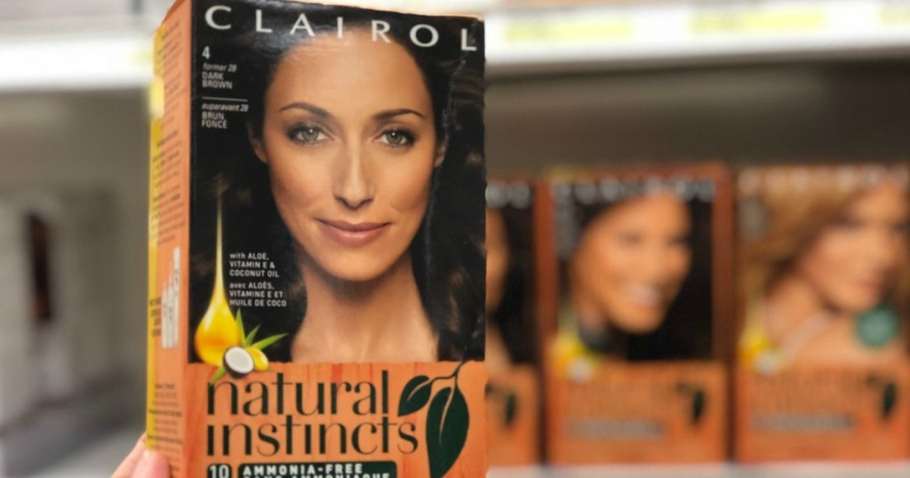 hand holding box of Clairol Natural Instincts hair color
