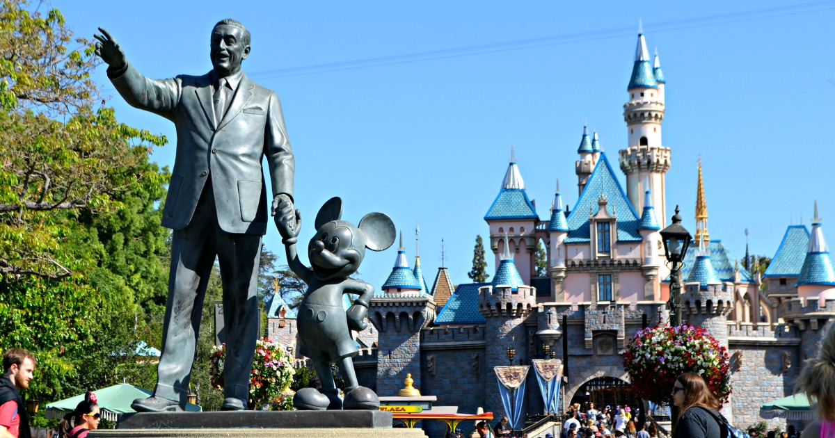 statue with Mickey Mouse by Cinderella's castle